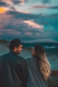How depression affects relationships. Couple standing in front of stormy sky