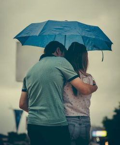 How depression affects relationships. Couple standing under an umbrella